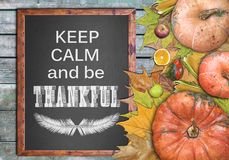 Wooden frame keep calm and be thankful. Close Stock Photo