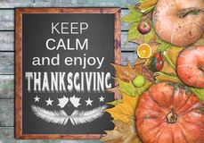Wooden frame keep calm and enjoy thanksgiving stock images