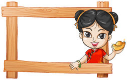 A wooden frame with a lady Stock Images