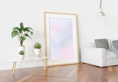 Wooden frame leaning in bright white living room with plants and decorations mockup 3D rendering royalty free illustration