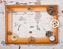 Wooden frame and mechanical clock Stock Photos