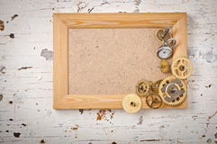 Wooden frame and mechanical clock Royalty Free Stock Photos