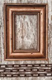 Wooden frame and metal chain on the old wood Royalty Free Stock Photos