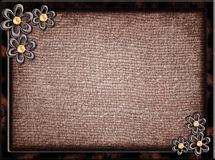 Wooden frame with metal flowers Stock Photos
