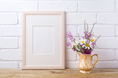 Wooden frame mockup with chamomile and purple flowers in golden stock images