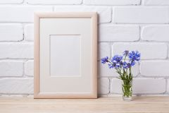 Wooden frame mockup with cornflower royalty free stock images