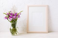 Wooden frame mockup with purple burdocks in jug Royalty Free Stock Images