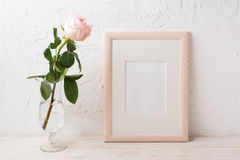 Wooden frame mockup with rose in exquisite glass vase Royalty Free Stock Photos