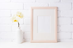 Wooden frame mockup with soft yellow orchid in vase Stock Photos