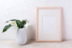 Wooden frame mockup with tender white lily in vase royalty free stock photos