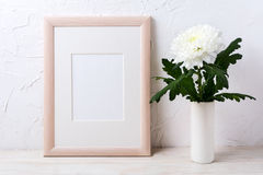 Wooden frame mockup with white chrysanthemum in vase. Empty frame mock up for presentation design stock photography