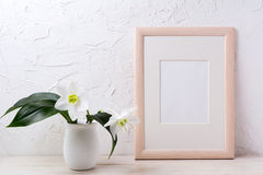 Wooden frame mockup with white lily in flower pot stock photography