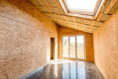 Wooden frame of a new house under construction. Interior stock photography