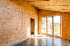 Wooden frame of a new house under construction. Interior stock photos
