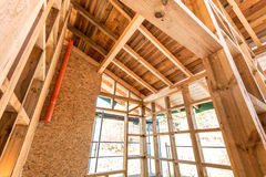 Wooden frame of a new house under construction Stock Photos