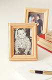 Wooden frame with old photo. With baby boy royalty free stock photo