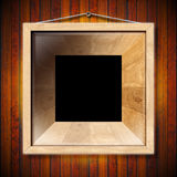 Wooden Frame on a Old Wood Wall Royalty Free Stock Image