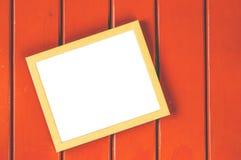 Wooden Frame On Orange Background. Wooden Frame For Quote On Orange Wood Background Stock Photography