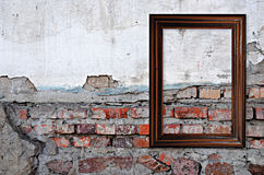Wooden frame over grunge brick wall Royalty Free Stock Photography