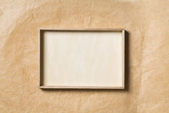 Wooden Frame over Paper Background, Empty Wood Papers Border Royalty Free Stock Images