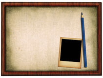 Wooden frame pencil and photo Stock Photos