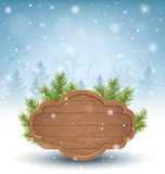 Wooden Frame with Pine Branches in Snow on Blue Royalty Free Stock Images