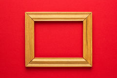 Wooden frame on red. Wooden frame on the bright red background Stock Photo