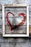 Wooden frame with red heart  on a grunge background Royalty Free Stock Photos