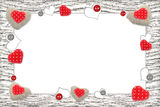 Wooden frame with red hearts Royalty Free Stock Photo