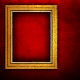 Wooden frame on red paint wall Stock Image