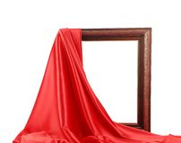 Wooden frame with red silk. Royalty Free Stock Photo