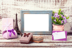 Wooden Frame and romantic accessories. With gift boxes on wooden background Royalty Free Stock Photo