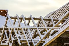 Wooden frame of the roof during construction works on a new hous. E Stock Images
