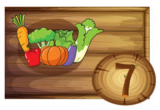 A wooden frame with seven vegetables. Illustration of a wooden frame with seven vegetables on a white background Royalty Free Stock Photos