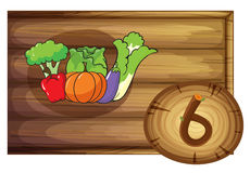 A wooden frame with six vegetables Stock Images