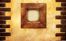 Wooden frame on stucco wall Stock Photography
