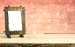 Wooden frame on table with bokeh background Stock Photography