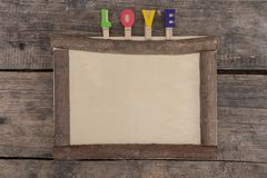 Wooden frame on the wooden table stock photos