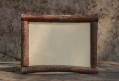 Rown wooden frame on the wooden tablewith stone background stock photography