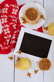 Wooden frame on the table with pears, waffles and red cloth. Vertical view Stock Image
