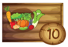A wooden frame with ten vegetables Stock Photos