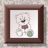 Wooden frame on textured wall with teddy bear drawing royalty free stock photography