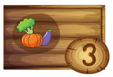 A wooden frame with three vegetables Stock Images