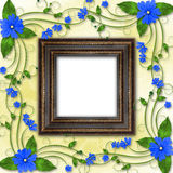 Wooden frame in the Victorian style. With blue flowers Stock Photography