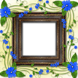 Wooden frame in the Victorian style. With blue flowers Royalty Free Stock Photo