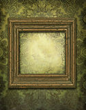 Wooden frame with vintage background. Wallpaper vintage with grunge effects and a wooden frame dusty and scratched Stock Image