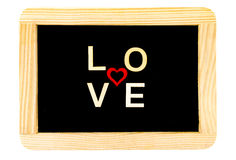 Wooden frame vintage chalkboard isolated on white with word LOVE created of wood letters Royalty Free Stock Photography