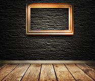 Wooden frame on a wall. Stock Images