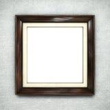 Wooden frame on wallpaper Stock Photos