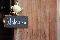 Wooden frame WELCOME over old wooden door Royalty Free Stock Photos